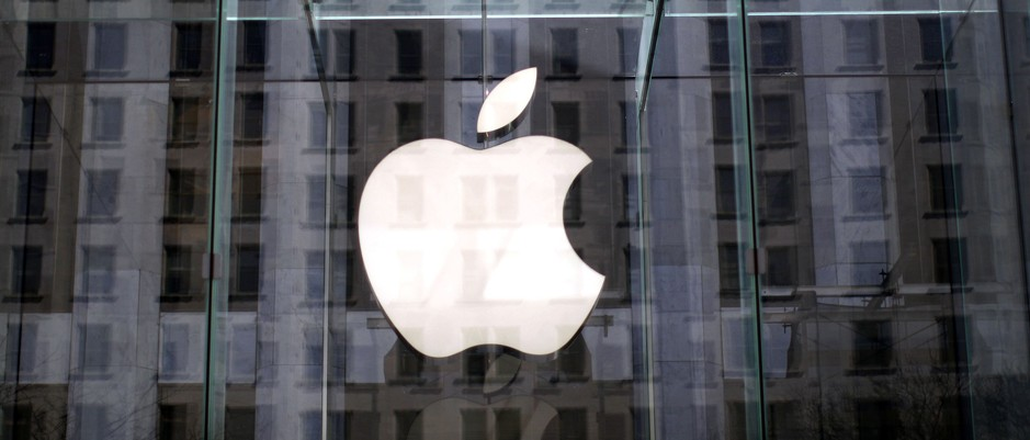 The Apple logo hangs inside the glass entrance to the Apple Store on 5th Avenue in New York City,